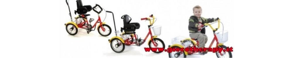Tricicli per bambini con disabilità